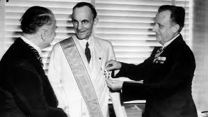Henry Ford receiving the Grand Cross of the German Eagle in 1938